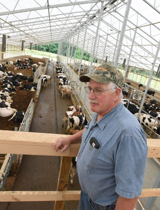 Dairy farmer Dave Bitler oversees his robotized dairy milking facility in Fleetwood, Pa. with AMS Galaxy